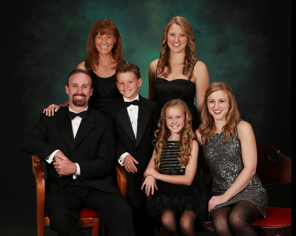 Happy family in formal attire